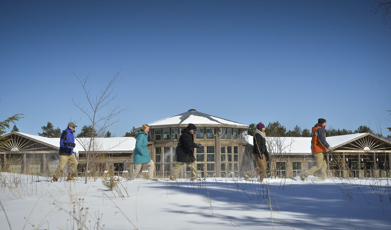 Snowshoeing in front of The Wild Center