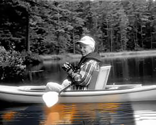Linda Vaughan photographing in her kayak